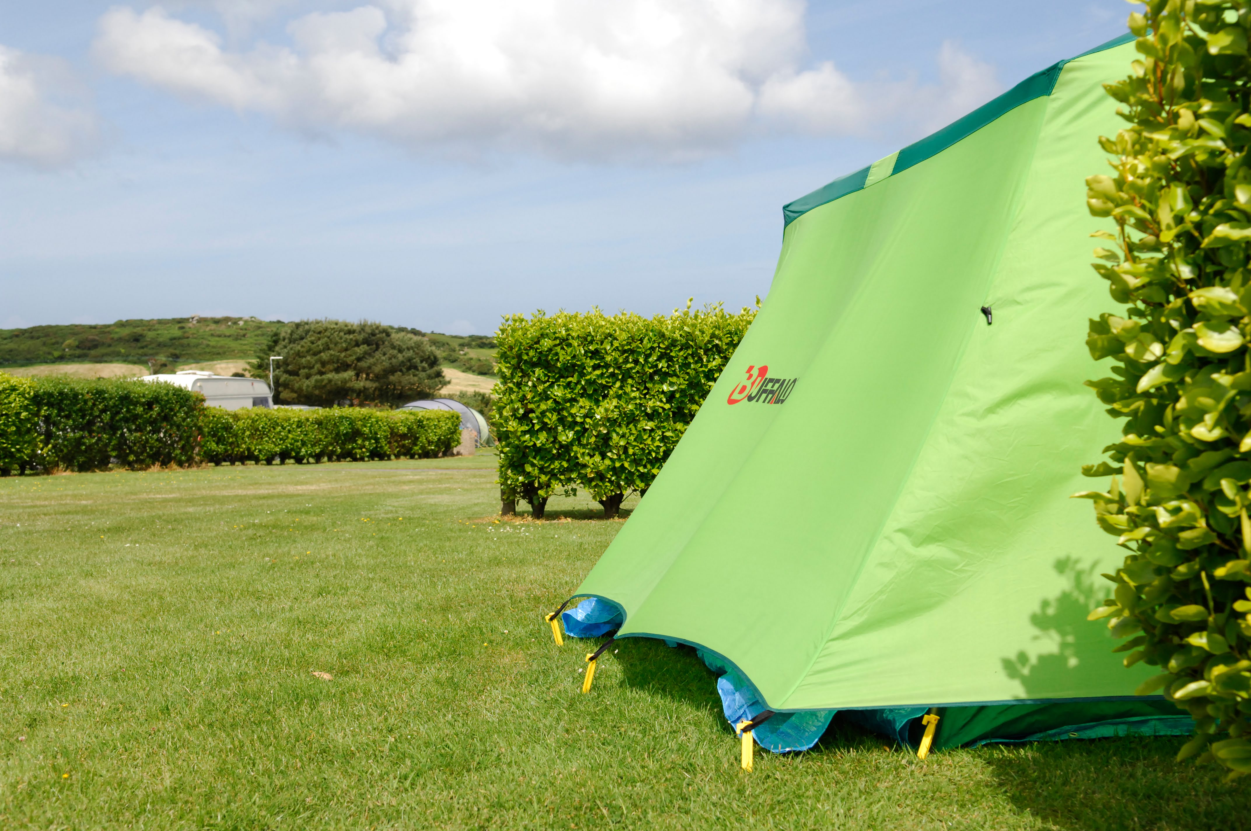 Side view of green tent pitched at Polmanter