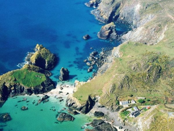Looking down on the turquoise waters of Kynance Cove from the cliff top