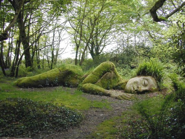 sleeping lady made from stone, moss and grass at the lost gardens of heligan